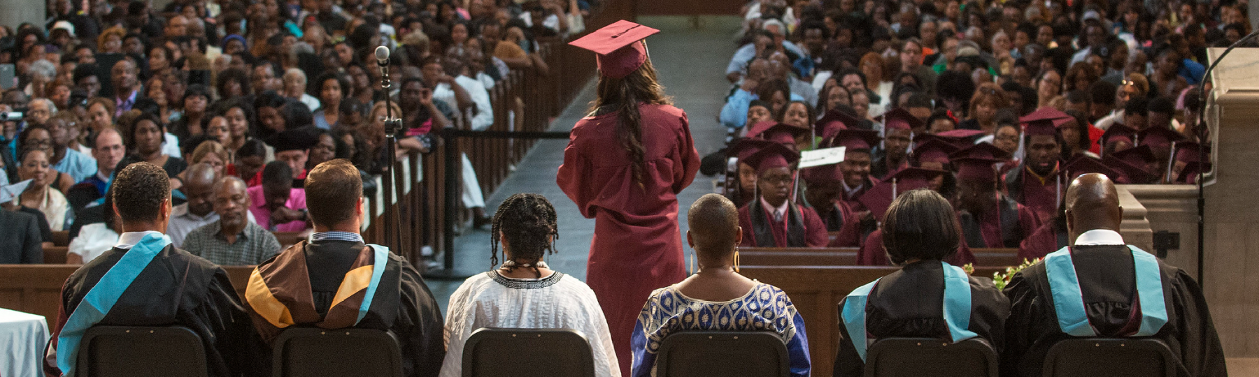 A high school senior gives her graduation speech at the ceremony