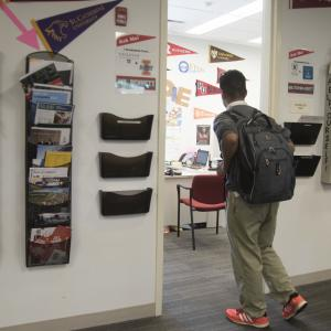 A high school senior walks into his college counselor's office.